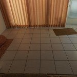 Tile to be removed by SafeDry terrazzo Restoration in Florida